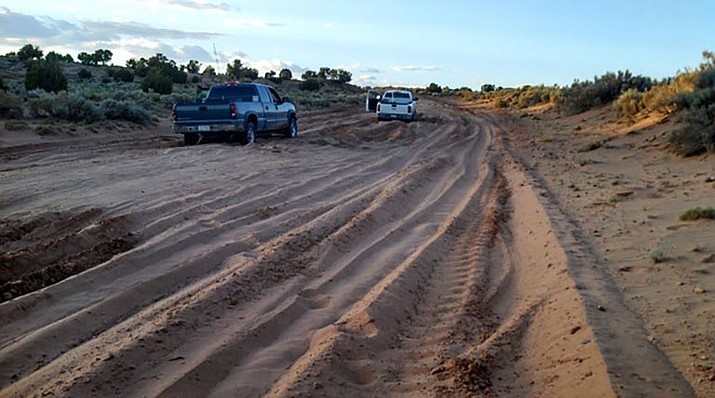 """Many of roads in tribal areas, like the Navajo Nation, are unpaved and become impassable during bad weather, which is why roads are just one of the targets of the Biden administration's infrastructure plan. Native Americans have been on """"the short end"""" of infrastructure investment over the years, an administration official said. (Photo/Navajo County Public Works Department)"""