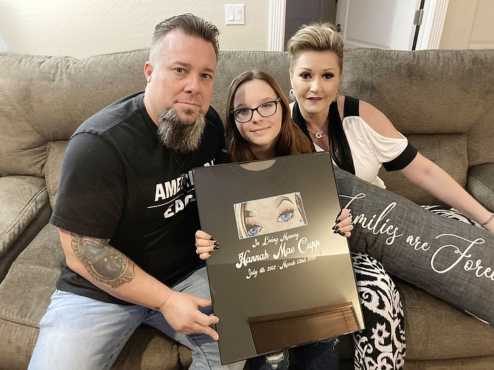 The Cupp family holds a T-shirt tribute to their daughter, Hannah Mae Cupp, who died of fentanyl intoxication on March 22, 2020. She was 17. Pictured are parents Mike and Sommer Cupp with 12-year-old sister, Randi, center. According to MatForce's Overdose Fatality Review Board report, fentanyl was detected in the system of 42 of the 82 deaths chronicled. (Nanci Hutson/Courier, file)