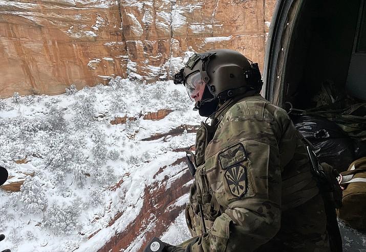 An Arizona Army National Guard U-H 60 Blackhawk crew was called in to rescue three stranded climbers in snowy Haribo Canyon near Sedona on Jan. 26, 2021. (Photo by Maj. Kyle Key/Arizona National Guard)
