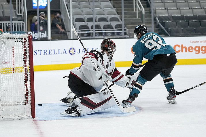 San Jose Sharks left wing Rudolfs Balcers (92) scores a goal past Arizona Coyotes goaltender Darcy Kuemper (35) during the first period of an NHL hockey game Wednesday, April 28, 2021, in San Jose, Calif. (Tony Avelar/AP)