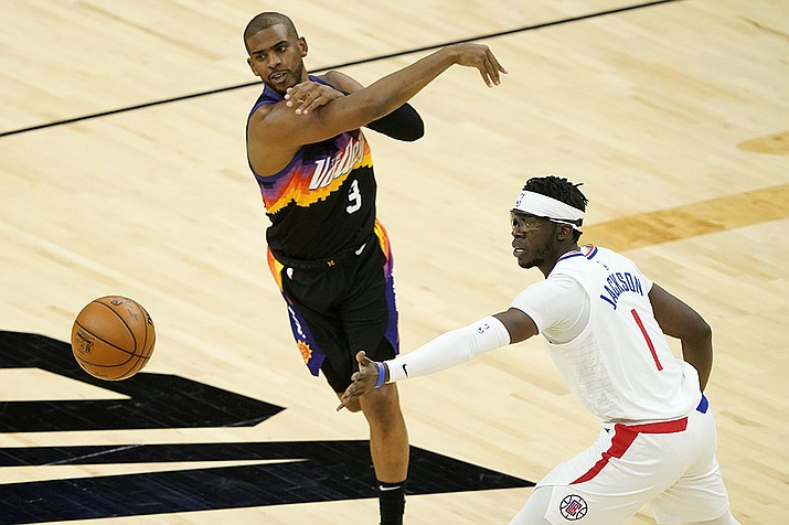 Phoenix Suns guard Chris Paul (3) passes as Los Angeles Clippers guard Reggie Jackson (1) defends during the first half of an NBA basketball game, Wednesday, April 28, 2021, in Phoenix. (Matt York/AP)