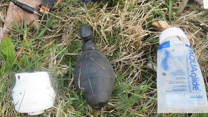Officials in Germany say a grenade-shaped object discovered in a clear plastic bag in a forest near the city of Passau was actually a sex toy. When a bomb squad arrived and inspected the contents of the bag, they determined it was a rubber grenade replica. The condoms and lubricant in the bag helped inform the hypothesis about the device's intended use. (Hauzenberg Police)