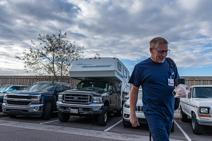 "While working on the road, David Ryan showers, cooks and sleeps in his camper. He tries to remain upbeat about his job, despite the toll it takes. ""I'm very proud of being a travel nurse. I'm proud of coming in and being the help."" (Photo by Isaac Stone Simonelli/Special for Cronkite News)"