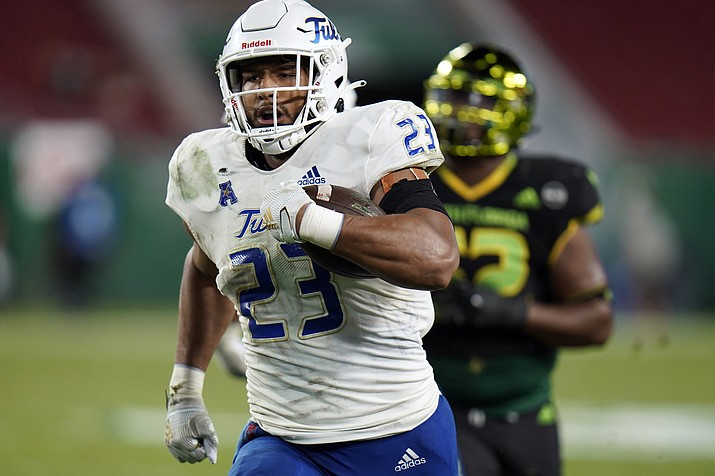 In this Oct. 23, 2020, file photo, Zaven Collins (23) runs back an interception for a score against South Florida. Collins was selected by the Arizona Cardinals with the 16th overall pick in the NFL Draft on Thursday, April 29, 2021. Collins, who played for Tulsa, is a small-town player with big-time talent. He was overlooked after a stellar high school career in Hominy, Okla., a town with about 3,500 people. (Chris O'Meara/AP, file)
