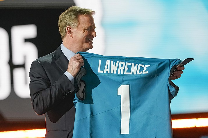 NFL Commissioner Roger Goodell holds a Jacksonville Jaguars jersey as he announces that the Jaguars had chosen Clemson quarterback Trevor Lawrence with the first pick in the NFL football draft, Thursday April 29, 2021, in Cleveland. (Tony Dejak/AP)