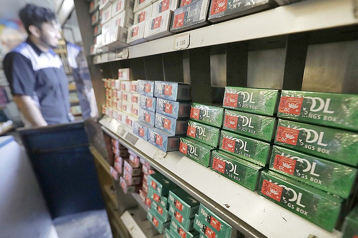 This May 17, 2018 file photo shows packs of menthol cigarettes and other tobacco products at a store in San Francisco. On Thursday, April 29, 2021, the Food and Drug Administration pledged again to try to ban menthol cigarettes, this time under pressure from African American groups to remove the mint flavor popular among Black smokers. (Jeff Chiu, AP File)
