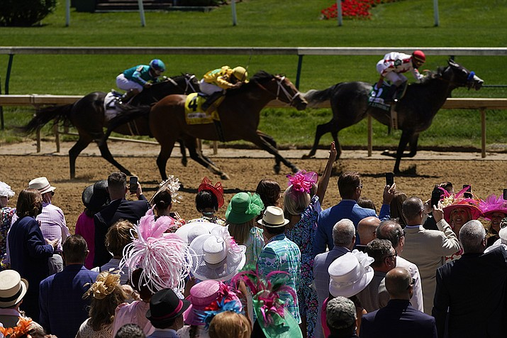 Fans watch race six before 147th running of the Kentucky Oaks at Churchill Downs, Friday, April 30, 2021, in Louisville, Ky. (Charlie Riedel/AP)