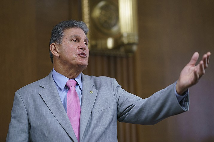 Sen. Joe Manchin, D-W.Va., chair of the Senate Energy and Natural Resources Committee, arrives to hold a confirmation hearing for Tommy Beaudreau of Alaska, to be deputy secretary of the Department of the Interior, at the Capitol in Washington, Thursday, April 29, 2021. (J. Scott Applewhite/AP)