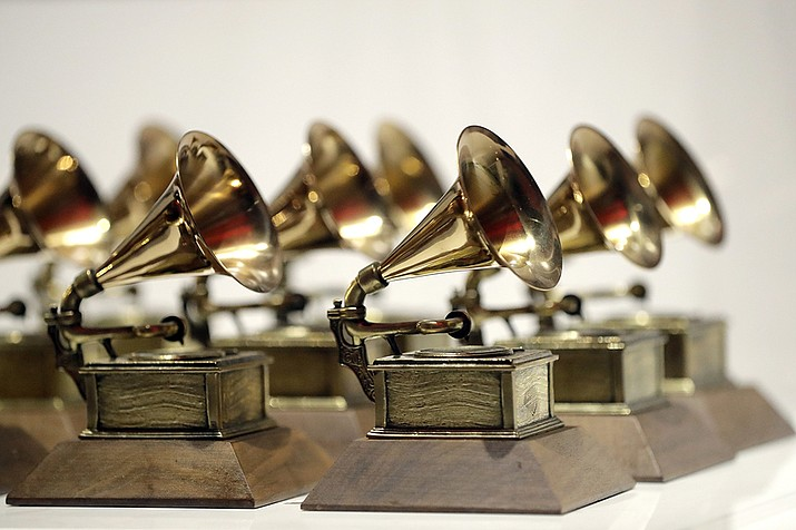 In this Oct. 10, 2017, file photo, various Grammy Awards are displayed at the Grammy Museum Experience at Prudential Center in Newark, N.J. The Grammy Awards are in discussion to remove its nomination review committees — the group that determines the contenders for key awards at the coveted music show. ( Julio Cortez, AP File)