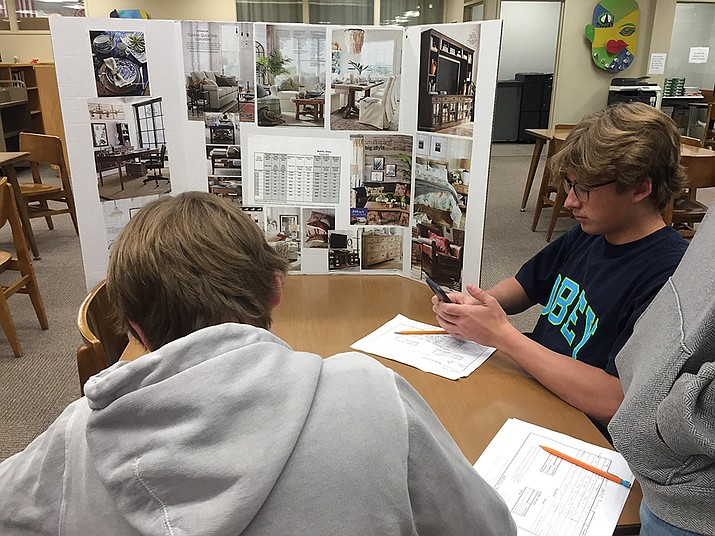 Students survey different booths offering information about costs of various items they might require when they begin life after graduation, be it buying a first car or buying a home based on their future plans. (PHS Freshman Academy instructor Jennifer Woods/Courtesy)