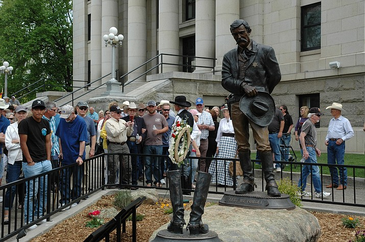 The Yavapai County Fallen Officers Memorial was unveiled Saturday, May 1, 2021, on the courthouse plaza in downtown Prescott. Bill Nebeker of Prescott is the artist who created the memorial's sculptures, which were bronzed. (Doug Cook/Courier)