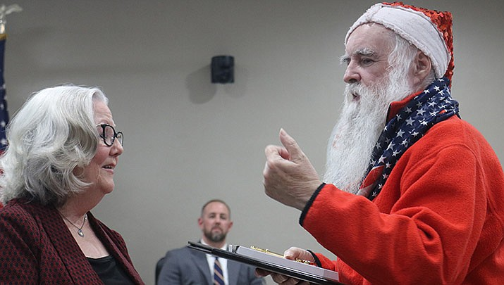 "Mayor Jen Miles presents ""Santa"" James Zyla with a Key to the City and the city's first Unity Award in 2019. (Miner file photo)"