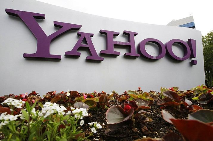 The Yahoo logo is displayed outside of offices in Santa Clara, Calif., in this Monday, April 18, 2011, file photo. Verizon is selling the segment of its business that includes Yahoo and AOL to private equity firm Apollo Global Management in a $5 billion deal. Verizon said Monday, May 3, 2021, that it will keep a 10% stake in the new company, which will be called Yahoo. (AP Photo/Paul Sakuma, File)