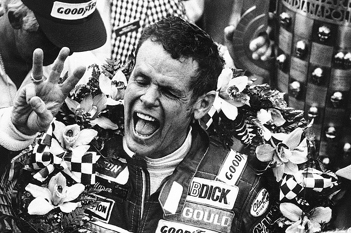 In this May 24, 1981, file photo, Bobby Unser holds three fingers aloft after winning his third Indianapolis 500 auto race ,in Indianapolis, Ind. Three-time Indianapolis 500 winner Bobby Unser has died. He died of natural causes at his home in Albuquerque, New Mexico, on Sunday, May 2, 2021. He was 87. (AP File)