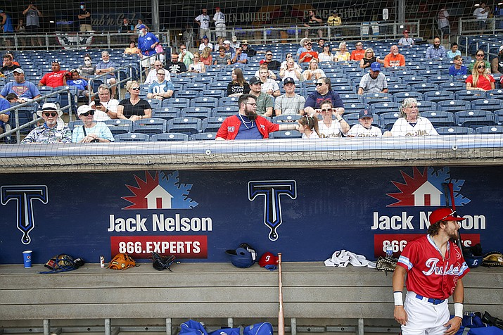 Tulsa Drillers' Hueston Morrill waits for his name to be announced at the Double-A baseball team's game against the Frisco RoughRiders in Tulsa, Okla., in this Tuesday, June 30, 2020, file photo. Minor league teams across the country are set to open their seasons Tuesday, May 4, 2021, returning baseball to communities denied the old national pastime during the coronavirus pandemic. (Ian Maule/Tulsa World via AP, File)
