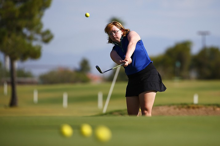 In this Aug. 28, 2019, file photo, Amy Bockerstette practices with her teaching pro at Palmbrook Country Club in Sun City, Ariz. Bockerstette is set to become the first person with Down syndrome to compete in a national collegiate athletic championship. (Ross D. Franklin/, file)