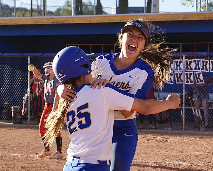 "Prescott softball outfielder Dana Seavey (1) celebrates with infielder Rylee ""RJ"" Parra (25) after Parra hit a walk-off triple during a game against Mingus on Monday, May 3, 2021, in Prescott. The Badgers defeated the Marauders 8-7. (Aaron Valdez/Courier)"