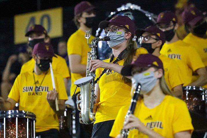 Sun Devil Marching Band members like Jillian Wright use a mask with a slit in the center, which allows her to play her instrument safely. (Photo by Alina Nelson/Cronkite News)