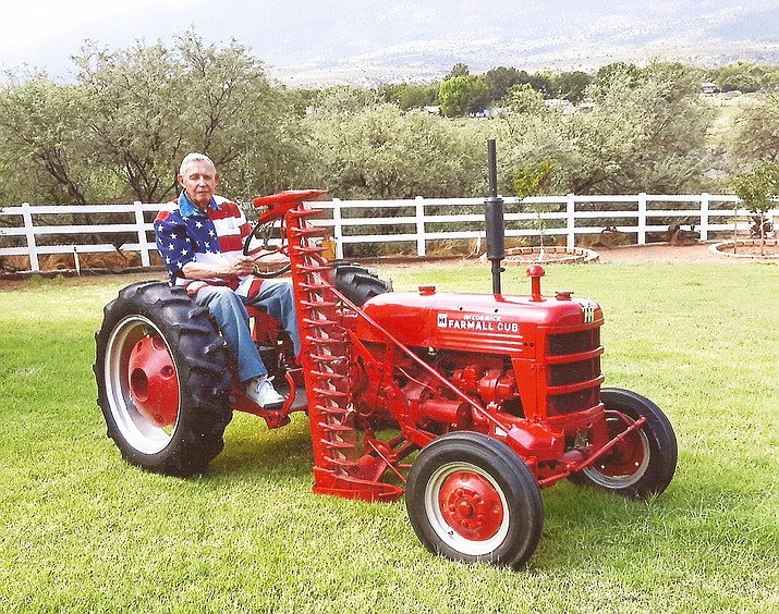 Rudy Valen of Camp Verde riding his fully restored Farmall Cub, the last one still in existence.