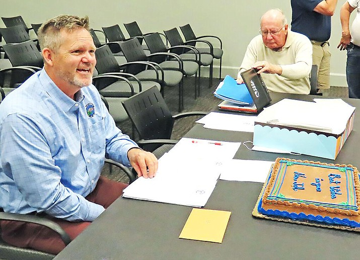 Dewey-Humboldt's new town manager, Edward Dickie, seen here at left in late April receiving a cake for his two years of service as town manager of St. James, North Carolina, began his tenure in D-H on Monday, May 2, 2021. (The State Port Pilot in Southport, North Carolina/Courtesy)