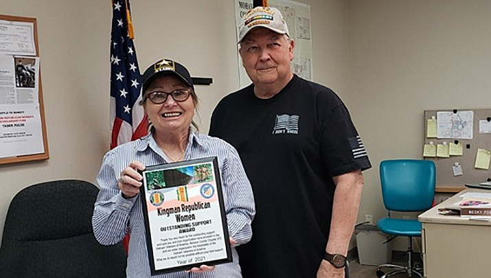 Mike Beard, president of Vietnam Veterans of America Mohave County Chapter 975, presents an Outstanding Support Award to Janet Wilson of the Kingman Republican Women for their support of Chapter 975. Wilson is KRW president and a Vietnam-era veteran. (Courtesy photo)