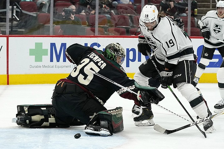 Los Angeles Kings right wing Alex Iafallo (19) beats Arizona Coyotes goaltender Darcy Kuemper (35) for a goal during the second period of an NHL hockey game Monday, May 3, 2021, in Glendale, Ariz. (Ross D. Franklin/AP)
