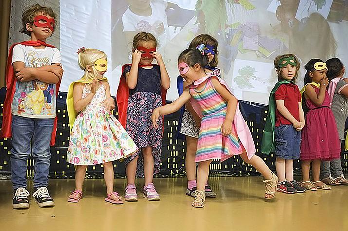 Children participate in a KinderCamp Bridging Over Ceremony. (Loretta McKenney/WGCN)