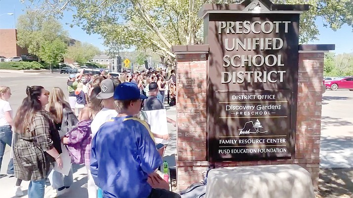Nearly 100 Prescott High School students march to the district office to protest the reinstated mask wearing mandate. (Courtesy)