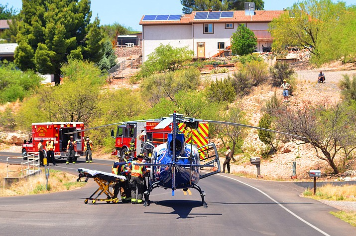 Native Air teamed up with Verde Valley Fire District, Yavapai County Sheriff's Office and Cottonwood Fire and Medical Department to respond to a roll-over accident on Eastern Drive in the residential section of Verde Village in Cottonwood Wednesday. VVN/Vyto Starinskas