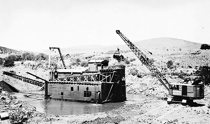 A dredge operated by the Calari Dredging Co. in 1933 at Lynx Creek near Prescott had a capacity of 100 cubic yards per hour. (Arizona Geological Survey)