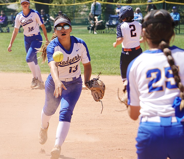 """Prescott softball infielder Makayla Reyes (13) tosses the ball to first baseman Rylee """"RJ"""" Parra to make a ground-out play during the first round of state playoffs against Poston Butte on Saturday, May 8, 2021, in Prescott. The Broncos defeated the Badgers 12-2. (Aaron Valdez/Courier)"""