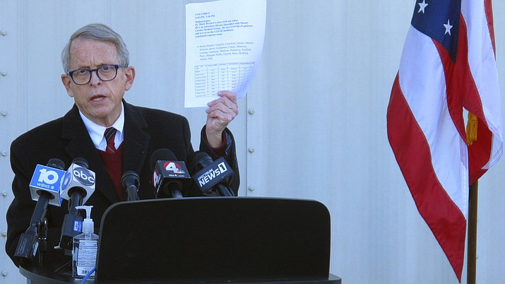 In this Nov. 18, 2020 photo, Republican Ohio Gov. Mike DeWine discusses the most recent data on Ohio's soaring coronavirus cases during a news briefing at John Glenn International Airport in Columbus, Ohio. (Andrew Welsh-Huggins/AP)