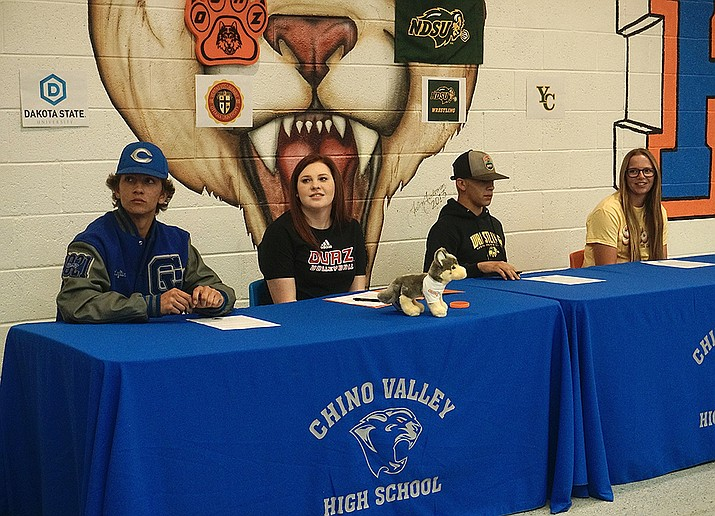 From left to right, Chino Valley athletes Kamren Loftin, McKenna Harris, Colby Evens and McKenna Smith sign their letters of intent to commit to playing their respective sports at the college level during a Signing Day event on Tuesday, May 12, 2021, at Chino Valley High School. (Aaron Valdez/Courier)