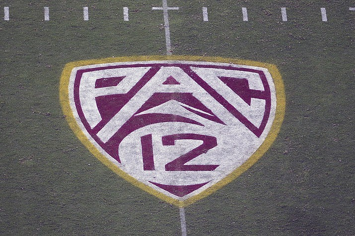 In this Aug. 29, 2019 photo, the Pac-12 logo is displayed on the field at Sun Devil Stadium during an NCAA college football game between Arizona State and Kent State in Tempe, Ariz. The Pac-12 hired sports entertainment executive George Kliavkoff to be the conference's next commissioner on Thursday, May 13, 2021, replacing Larry Scott with a person with a similar resume short on college sports experience. (Ralph Freso/AP, File)