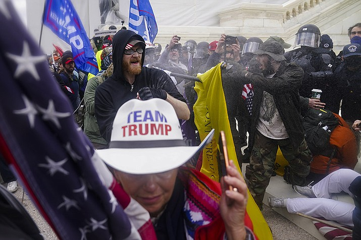 In this Jan. 6, 2021, file photo, rioters try to break through a police barrier, at the Capitol in Washington. (John Minchillo, AP File)