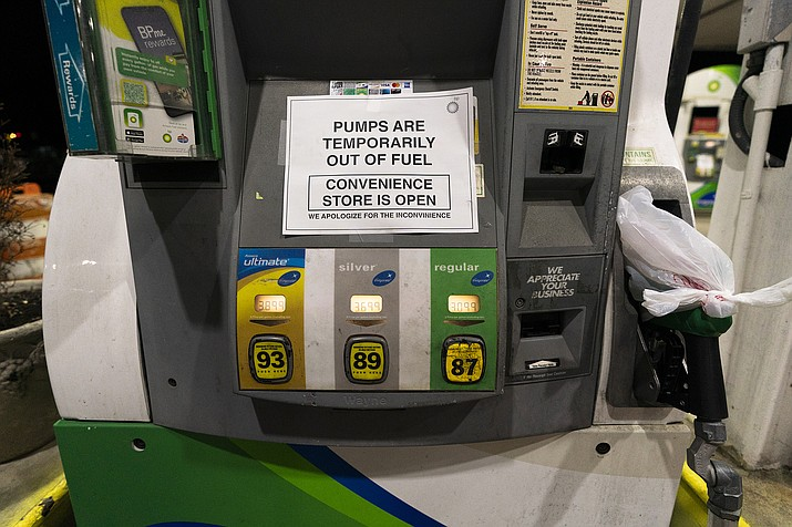 A pump at a gas station in Silver Spring, Md., is out of service, notifying customers they are out of fuel, late Thursday, May 13, 2021. (Manuel Balce Ceneta/AP)