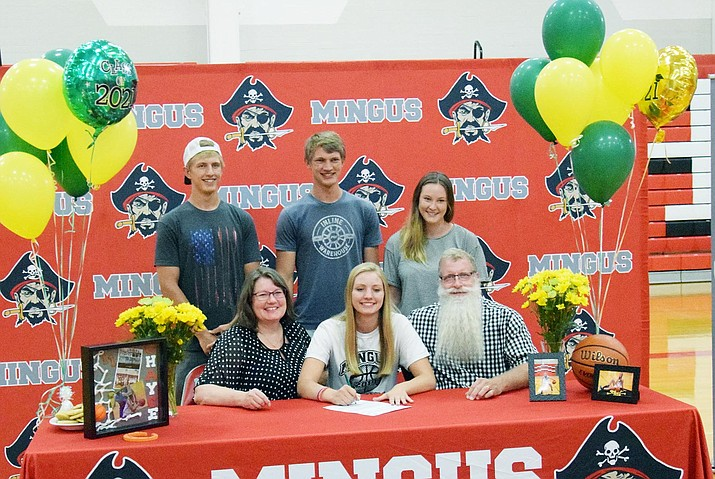 Mingus Union High School senior Chayce Doerksen hosted a signing ceremony Wednesday to commemorate her commitment to attend Central Arizona Junior College and play women's basketball. In front, from the left, are Doerksen and her parents, Jennifer and Steve. In back, from the left, are Doerksen's brother, Nick and Lucas, and her sister-in-law, Mackenna Doerksen. VVN/Jason W. Brooks