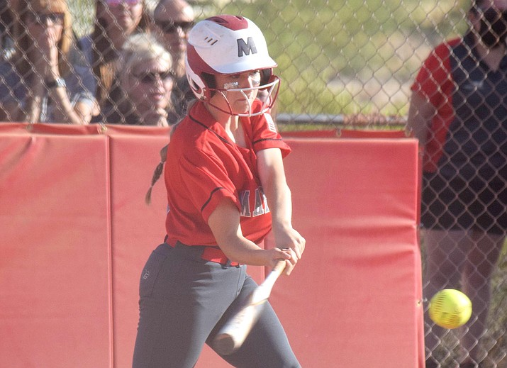 Mingus Union senior Tabitha Freeman launches an RBI double in Tuesday's season-ending state 4A quarterfinal loss to Paradise Honors. The Marauders rallied twice to tie the contest. VVN/Jason W. Brooks