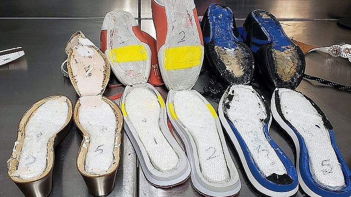 Customs officers at the Atlanta airport stopped a 21-year-old woman last week after she arrived on a flight from Jamaica. Her bags were inspected, and seven pairs of shoes were found to have $40,000 worth of cocaine hidden in the soles. (U.S Customs and Border Protection)