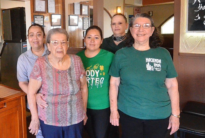 From the left, Teresa Vesquez, Vera Varela, Lupe Vega, Vera's daughter Anna Rodriguez, and Rosie Lee pose for a photo inside Cottonwood's Hacienda Inn last week. The restaurant will end its 49-year run on State Route 89A on May 22. VVN/Vyto Starinskas