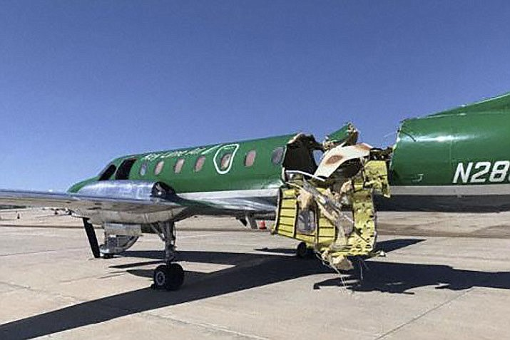 This image from CBS Denver shows a Key Lime Air Metroliner that landed safely at Centennial Airport after a mid-air collision near Denver on Wednesday, May 12, 2021. Federal officials say two airplanes collided but that there are no injuries. The collision between a twin-engine Fairchild Metroliner and a single-engine Cirrus SR22 happened as both planes were landing.(CBS Denver via AP)