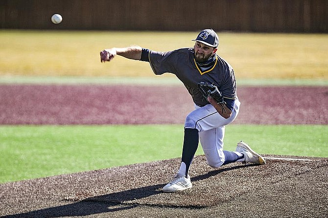 Augustana pitcher Parker Hanson throws during a baseball game against Minnesota Crookston on Tuesday, March 30, 2021 at Ronken Field in Sioux Falls. S.D. Hanson, whose prosthetic arm was stolen from his vehicle, got it back Tuesday, May 11, 2021, after it was found at a recycling plant. (Erin Bormett/The Argus Leader via AP)