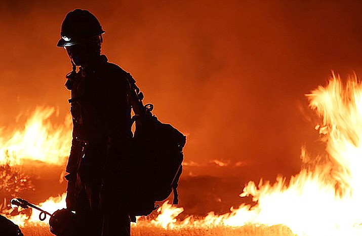 An Arizona wildland firefighter battles a blaze in 2020. Forecasts show the dry southwestern United States could be in for a rough wildfire season. File photo