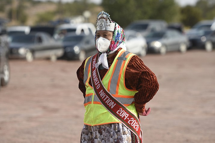 """This photo of Miss Navajo Nation distributing food at Ganado, Arizona Oct. 2, 2020 is part of the National Museum of the American Indian's """"Developing Stories: Native Photographers in the Field"""" series. (Photo/Navajo Times, 2020 via Smithsonian)"""