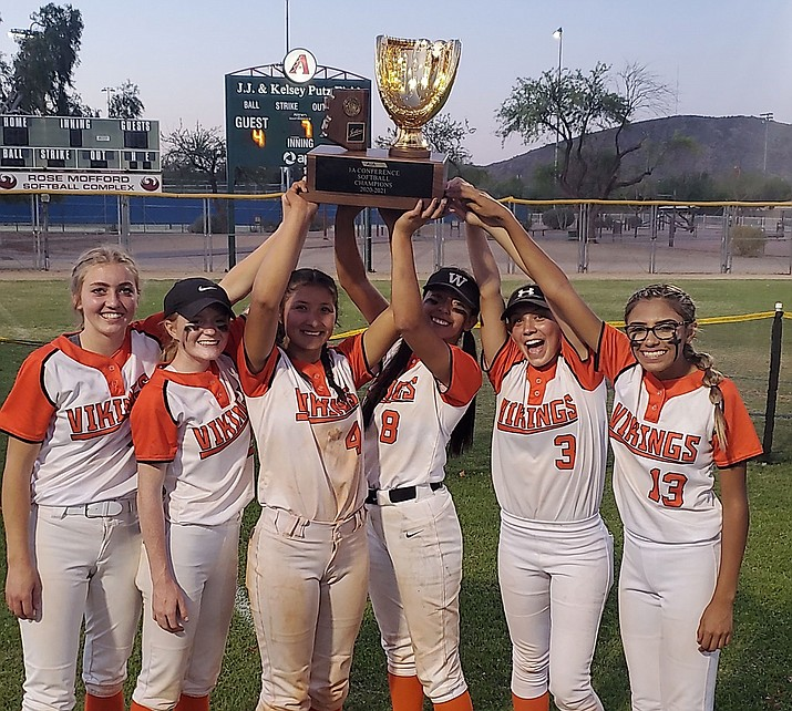 Williams Vikings softball players celebrate their 1A State Championship win over the San Manuel Miners May 15 at Rose Mofford Field in Phoenix. The Vikings beat the Miners 6-4 to claim the title. (Photo/Shelby Alvarado)