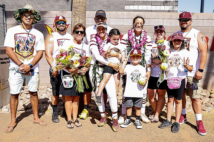 Members of the Hackbarth family often wear T-shirts that support the twins, as they did on Senior Day for the softball team. (Marlee Smith/Cronkite News