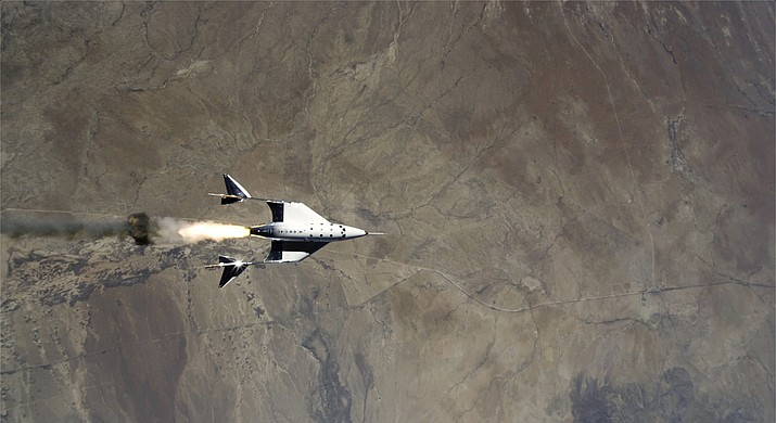 This Saturday, May 22, 2021 image shows the release of VSS Unity from VMS Eve and ignition of rocket motor over Spaceport America, N.M. Virgin Galactic completed its third spaceflight and the first-ever spaceflight from Spaceport America, N.M. (Virgin Galactic via AP)