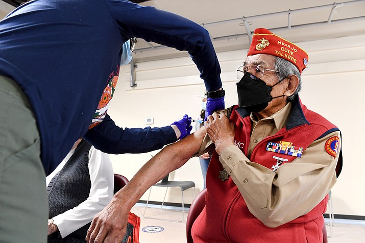 Navajo Code Talker Peter MacDonald receives a vaccine shot at Tuba City Regional Health Care Corp. MacDonald said the vaccine is the beginning of the end to the pandemic said everyone should get one. (Photo courtesy Tuba City Regional Health Care Corp.)