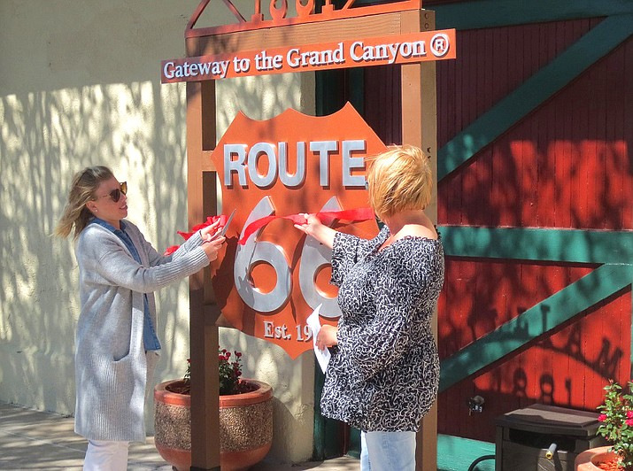 Williams Visitor Center employees unveil improvements made with a grant from the Historic Route 66 Association of Arizona May 21.  (Submitted photo)