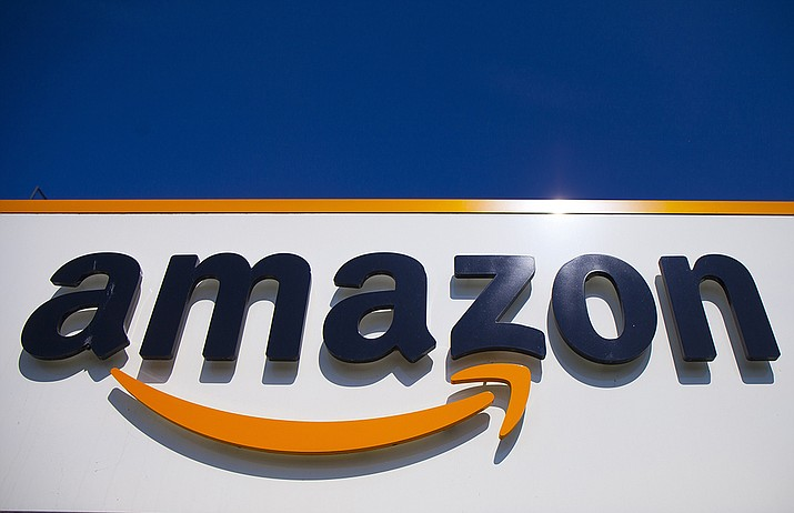 In this April 16, 2020, file photo, the Amazon logo is displayed in Douai, northern France. Amazon said Tuesday, May 18, 2021, that it will continue to ban police use of its face-recognition technology beyond the one-year ban it announced last year. (Michel Spingler, AP File)